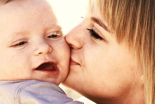 Speak to your baby cheek to cheek, sound is vibration to an infant!